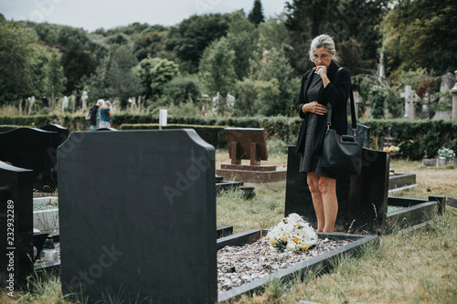 Photo  Old woman mourning her husband