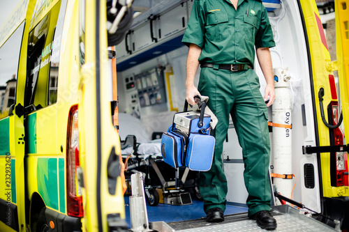 Paramedics at work with an ambulance Canvas Print