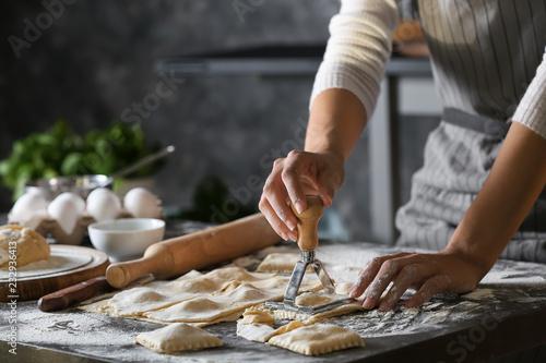 Fényképezés Woman making tasty ravioli on table