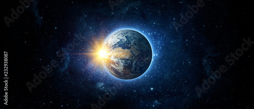 Panoramic view of the Earth, sun, star and galaxy. Sunrise over planet Earth, view from space. Elements of this image furnished by NASA - 232938087