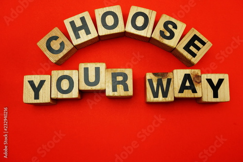 Photo  choose your way word created with cubes alphabet letters on red background
