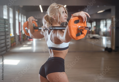 Fotografie, Obraz  strong sexy athletic young woman working out in gym