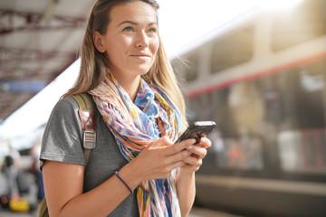 Fototapeta Young woman waiting for a train