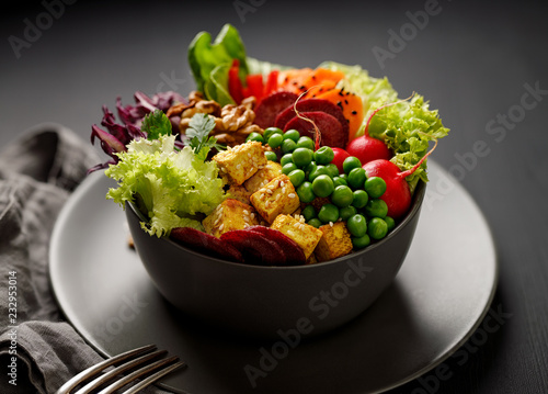 Buddha bowl,  healthy and nutritious salad with a variety of vegetables, nuts and tofu cheese,delicious and nutritious vegan meal