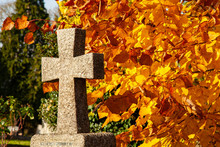 Granite Cross Against An Autumnal Background