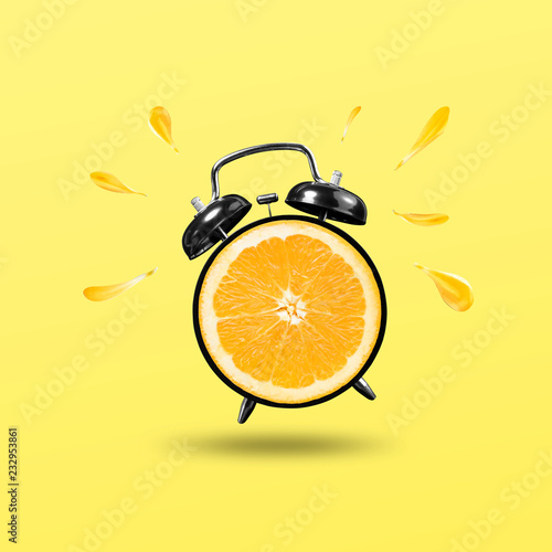 freshing time with orange clock on yellow