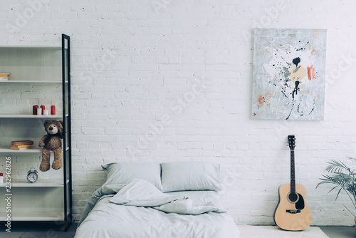 High Angle View Of Modern Bedroom With Shelves Guitar And Painting