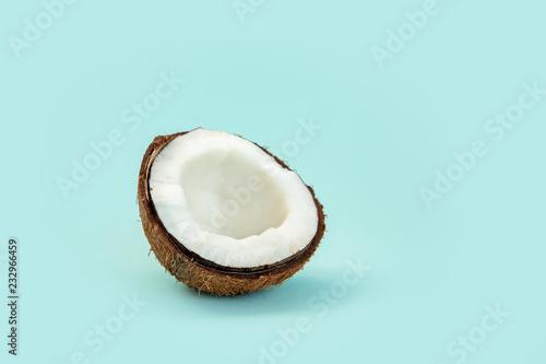 Fototapeta one half of ripe coconut on blue background obraz na płótnie