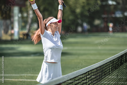 Fotografie, Obraz  Happy woman on the court