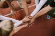 canvas print picture - Top view of basketball team holding hands over court