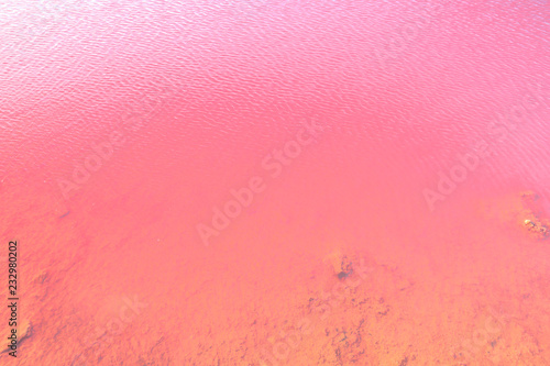 Foto op Aluminium Oceanië Natural pink water backgroung. Closeup of Pink Lake in Gregory, Western Australia. Salt lake or Hutt Lagoon with vivid pink color for the presence of algae in summer.