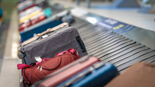 Passengers' Luggage Suitcase T...