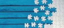 White Puzzle Pieces On Blue Ba...