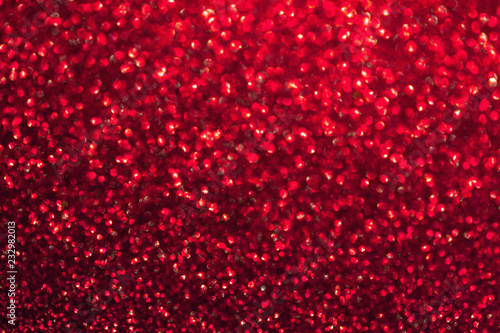 Fotografía  Blurred shiny red background with sparkling lights.