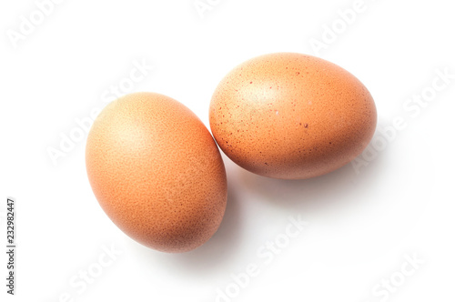 Photo closeup of two organic eggs on white background