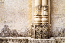 Wall Facade With Columns And With Floral Bas-relief. Architectural Decorative Element, Background