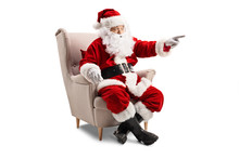 Santa Claus Sitting In An Armchair And Pointing