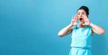 Young Woman Shouting On A Solid Background