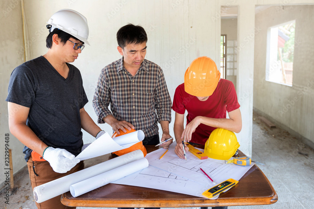 Fototapeta Engineer and architect discussing with foreman about project in building construction site