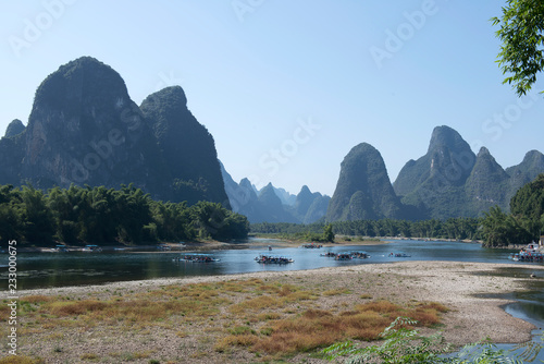 Fotobehang Guilin View over landscape of Yangshuo, Guanxi province, Guilin City, China. Li River and karst mountains top view. Travel, adventure and picturesque famous destination concept.