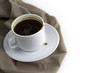 coffee cup on cloth napkin isolated on white background