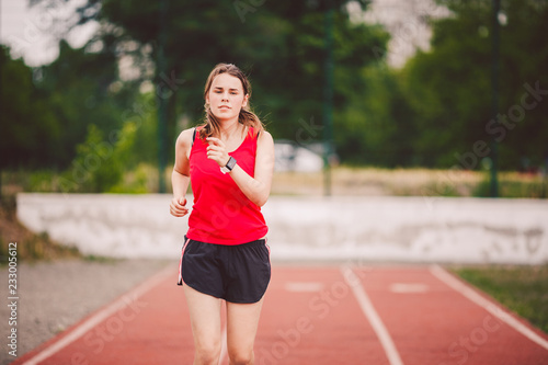 Fotografie, Obraz  Beautiful young athlete Caucasian woman with big breasts in red T-shirt and shor