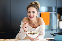 Beautiful Smiling Woman Eating...