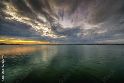 Spoed Foto op Canvas Zee zonsondergang Sunset over the lake