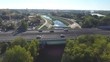 Car traffic on a bridge over a river in Montpellier drone aerial view. Sunny day