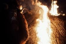 Traditional Buso Mask Of The Busojaras Event Next To A Bonfire