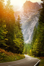 A Road Thru Mountain Pass In Dolomites During Autumn With Beautiful Colors, Italy, Europe