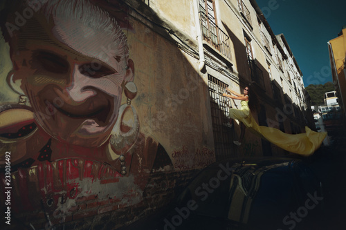 Climber on a city street. Wallpaper Mural