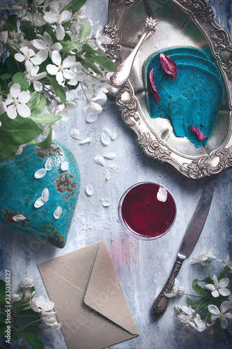 flatlay food background - empty wooden table with cheese pieces, red wine and silver antique dishwear