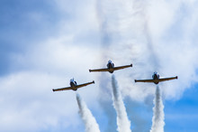 Three Jet Combat Training Aircraft Leave A Smoke Trail Against The Sky.