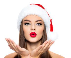 Obraz na PlexiThinking woman in a santa hat.