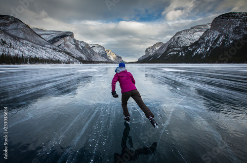 Foto op Plexiglas Bergen Ice skating at Lake Minnewanka, Banff National Park, Alberta, Canada
