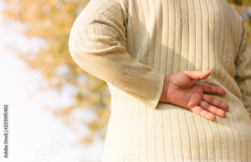 Valokuva  Senior woman with lower back pain