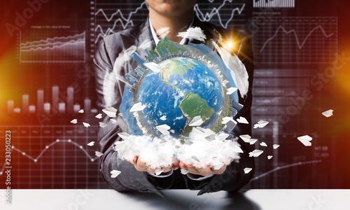 Businessman presenting Earth globe.