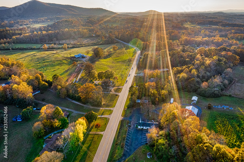 Photo sur Toile Vue aerienne Aerial shot of backlit road in Georgia Mountains during the sunset in the Fall
