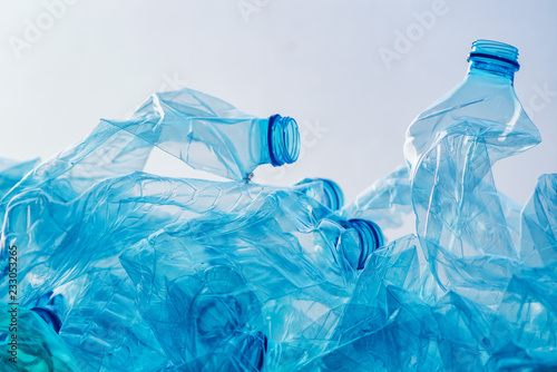 Fotografia  Crushed plastic bottles heap