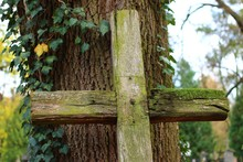 An Old Wooden Cross On The Cemetery