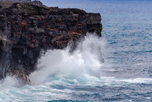 Large Waves Crashing Against Tall Volcanic Cliffs On Hawaii's Big Island, Below Chain Of Craters Road In Volcano National Park. Pacific Ocean In The Background.