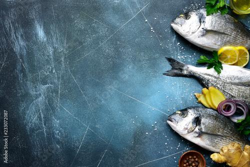 Fotografie, Obraz  Food background with fresh raw dorado fish with ingredients for making