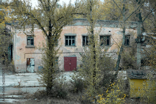 abandoned factory, view from behind the fence
