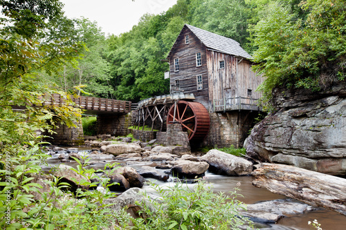 Glade Creek Grist Mill at Babcock State Park, West Virginia with stream and rock Canvas Print