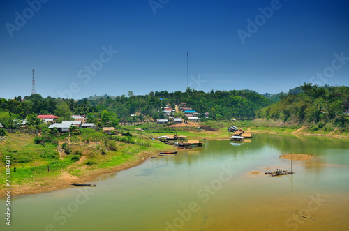 Foto op Canvas Stadion bridge over the river in the middle of the mountains. the Sagklaburi Kanchanaburi, Thailand