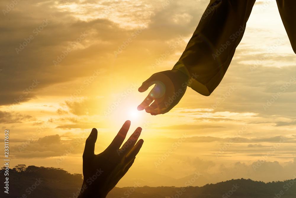 Fototapety, obrazy: Silhouette of Jesus giving helping hand