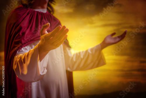 Jesus christ raising hands and praying