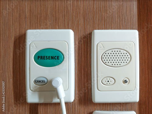фотографія  electronic background doorbell and speaker on wood wall in room
