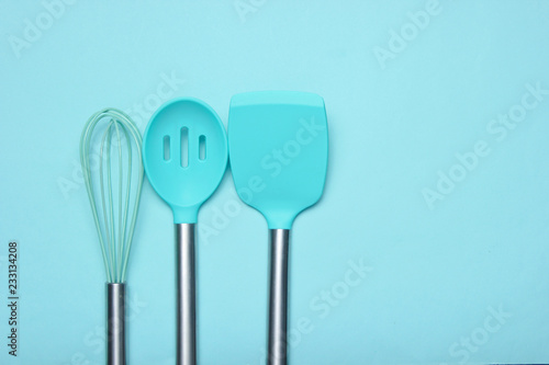 Fotografía  Set of tools for cooking on the blue background